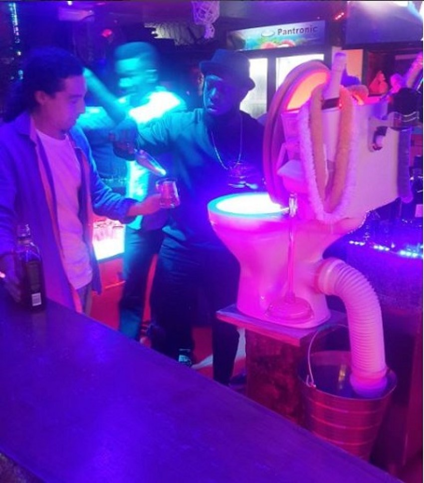 "TIMAYA SHOCKS FAN BY DRINKING OUT OF A ""TOILET"" ICE BUCKET IN A CLUB (PHOTOS)"