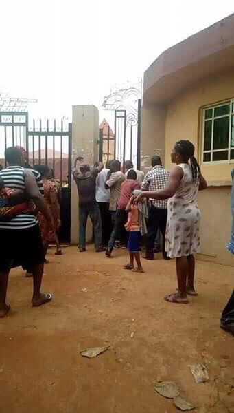 Image result for mom climbing a Rivers State as Parents rush to schools to pick their children over news of Soldiers coming to inject them (Photos)