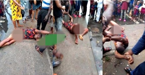 Crowd Gathered As Man Stopped from Stabbing Himself To Death In Apparent Suicide (Photo)