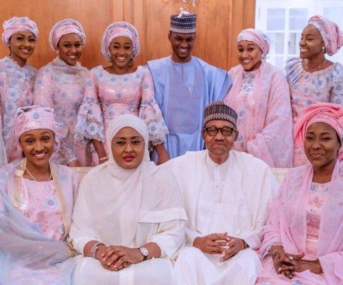 Buhari, his wife Aisha and his children