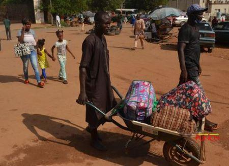 Abuja%20park3 - Passengers Besiege Abuja Park As FG Lifts Interstate Journey Ban (Photographs)