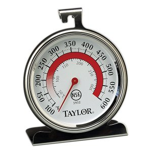 An analog oven thermometer. The case is metal and the dial reads from 100 to 600 degrees.