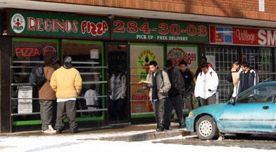 JPII students hanging outside of Regino's Pizza