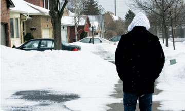 A University student walks along a street in Highland Creek