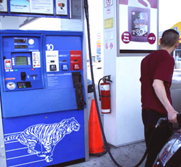 A local resident pumps at the Ellesmere Road Esso.