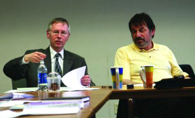 Governance Review Committee Chair Howard Goodman (right) and Peter Young (left) try to explain the issues to trustees on April 7.