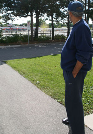 Lalith Salgado looks across the street at the Scarborough U-Haul refill station with concern.