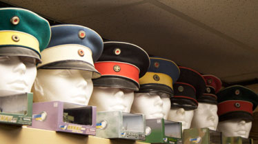 A collection of old military officer's hats at collectibles store Army Outiftters. Some people become passionate about collecting old military stuff.