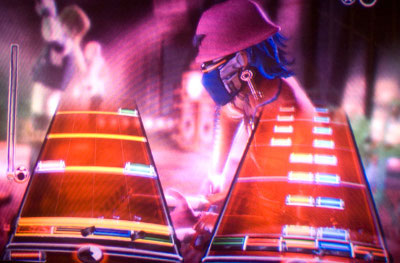 Players hit the notes on their instrument as their appear on the screen in quick succession. Failing to hit the proper notes with the proper timing can result in failing the song.