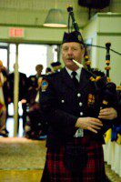 A piper opens the ceremony. (Amanada Ly/Toronto Observer)