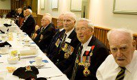 Second World War veterans share their stories as they wait for lunch. (Amanda Ly/Toronto Observer)