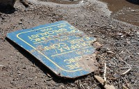 A metal sign on the beach. (Selena Mann/Toronto Observer)