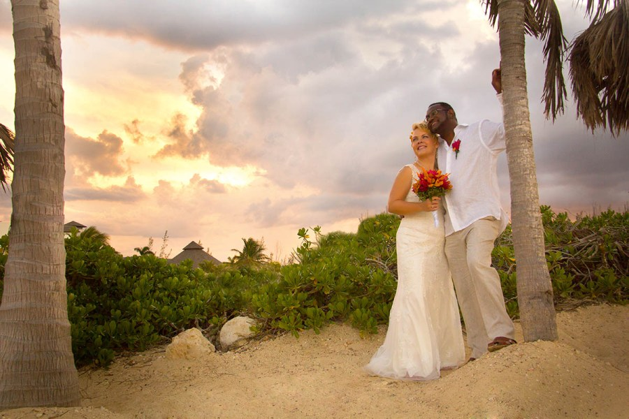 Wedding photo of couple on beach with dramatic sky