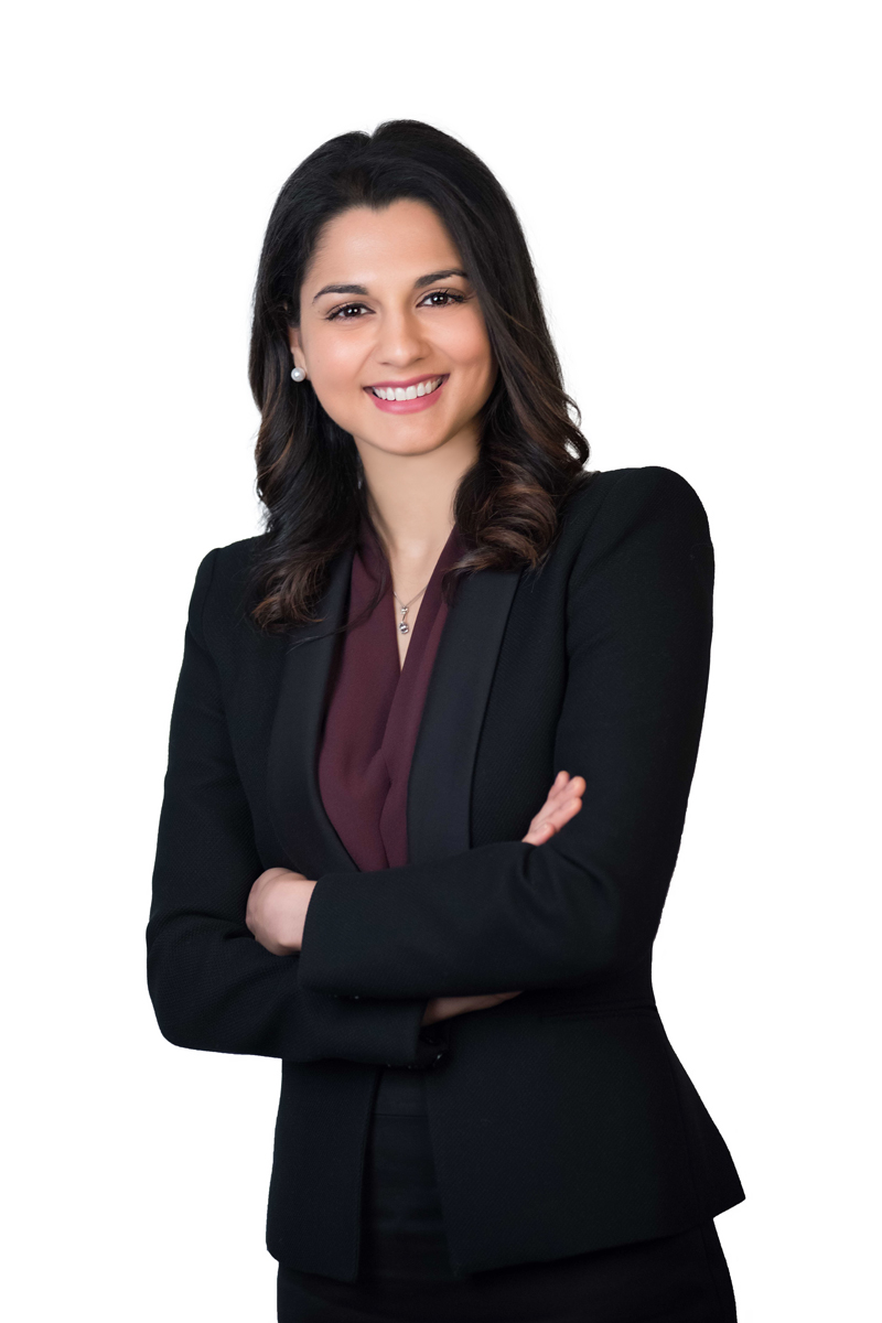 Business portrait of women standing against a white background half body shot