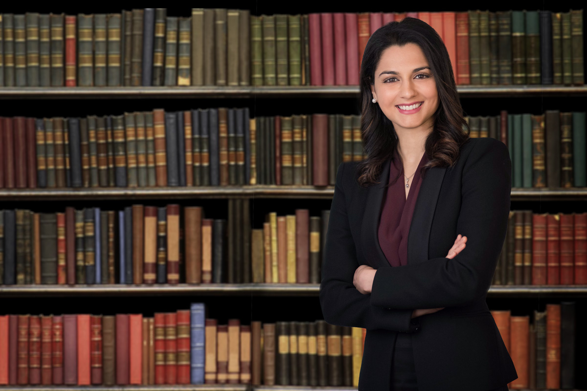 Business portrait for a female lawyer with books as background