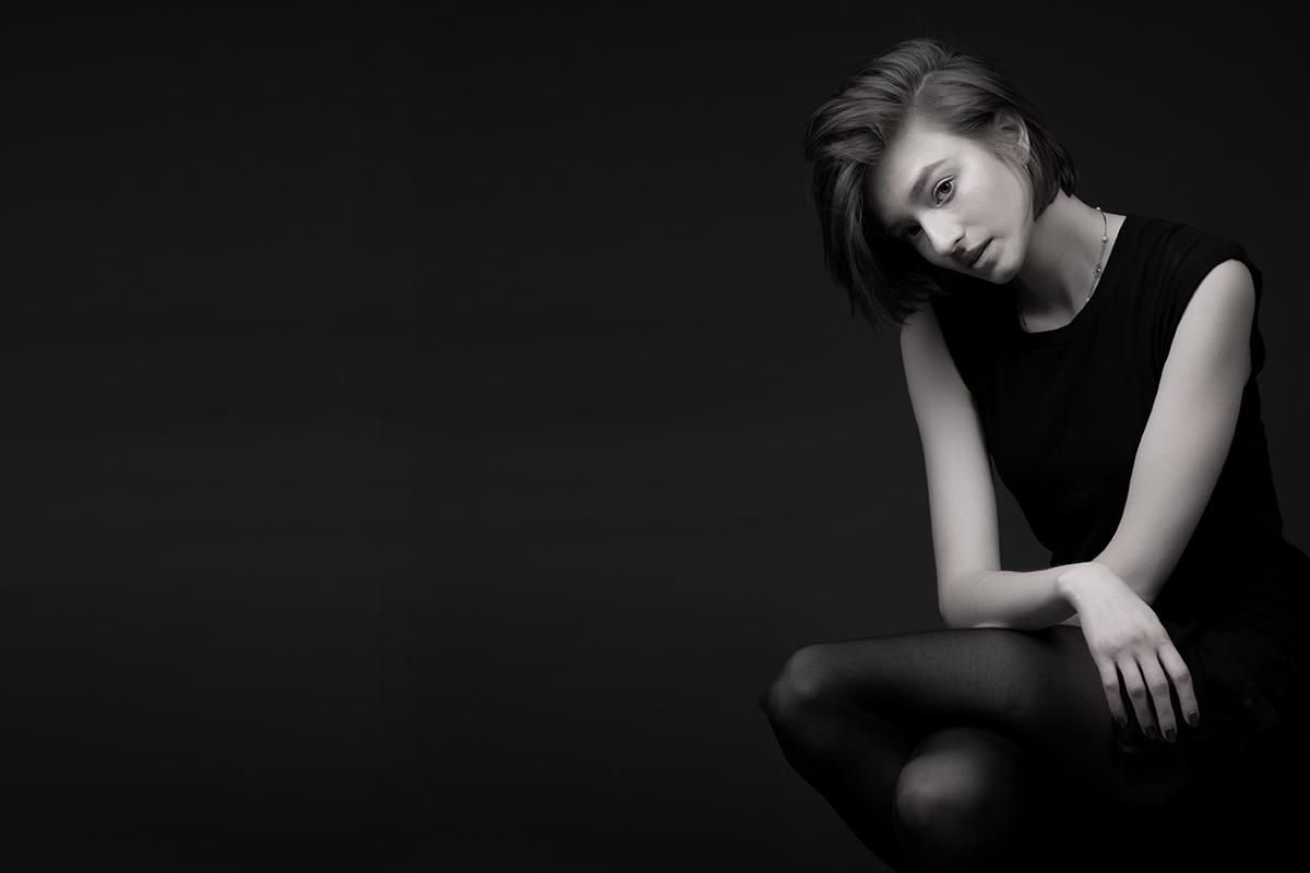 B+W fashion portrait of female with black background