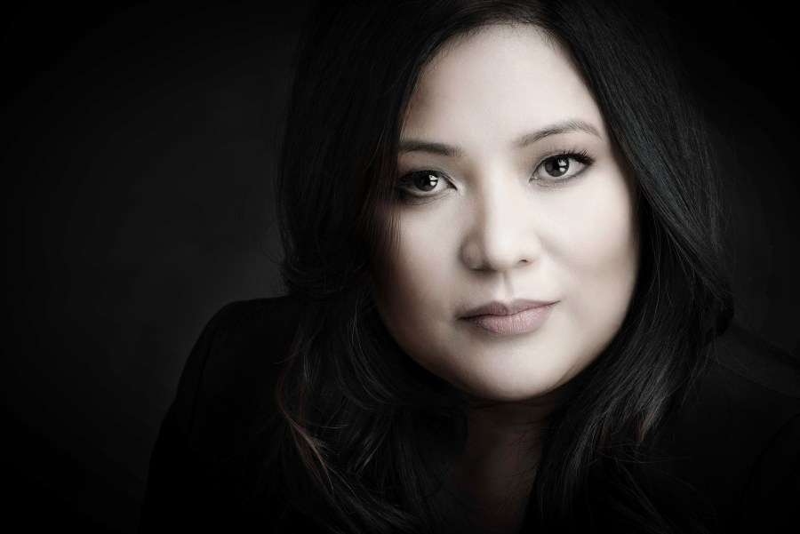 Asian women headshot with black background