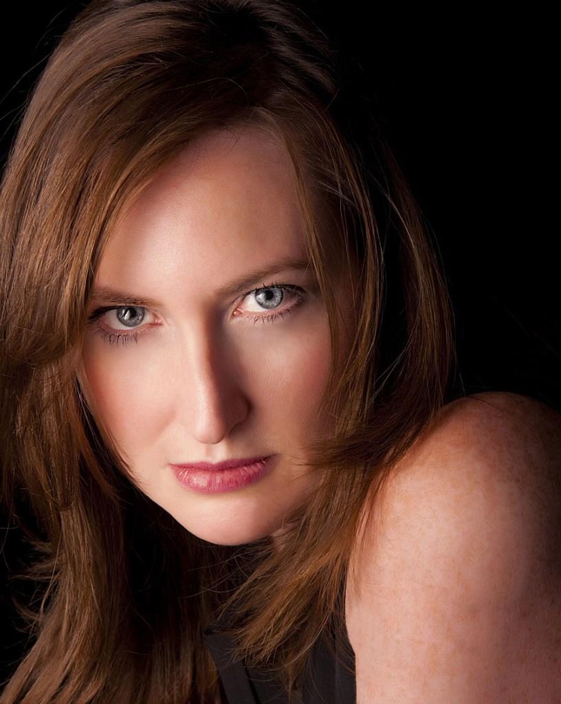 Red headed female studio portrait taken by professional photographer