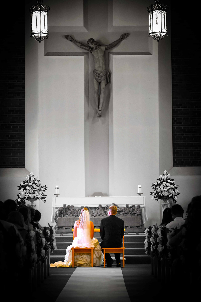 Bride and groom in the church and bride and groom are in color but the church is in B+W