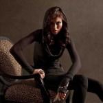 fashion portrait of women sitting in a chair in shadows