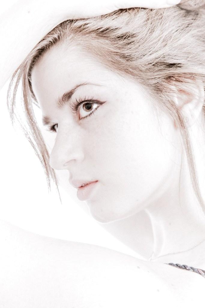 Model portfolio headshot of women looking away very brightly light