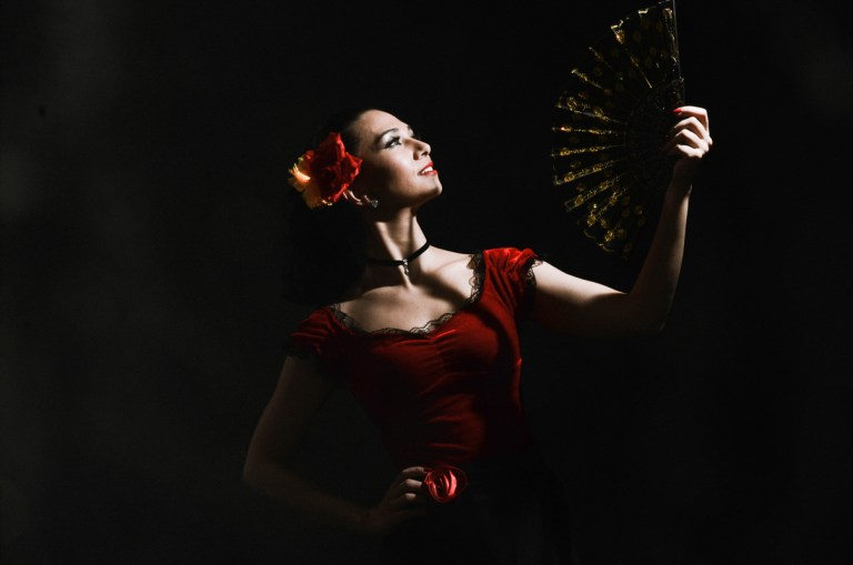 Flamenco dancer with dark background taken by professional photographyer