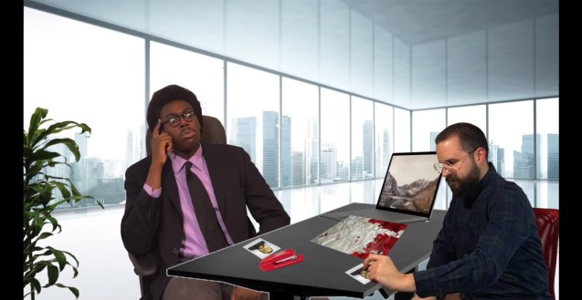 Mr. Beautiful has quickly tried the patience of his interviewer but persists on trying to win him over. They sit at a desk in an office with windows overlooking a cityscape.