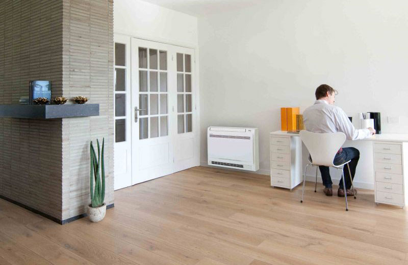 A floor standing air conditioner installed in a home office.