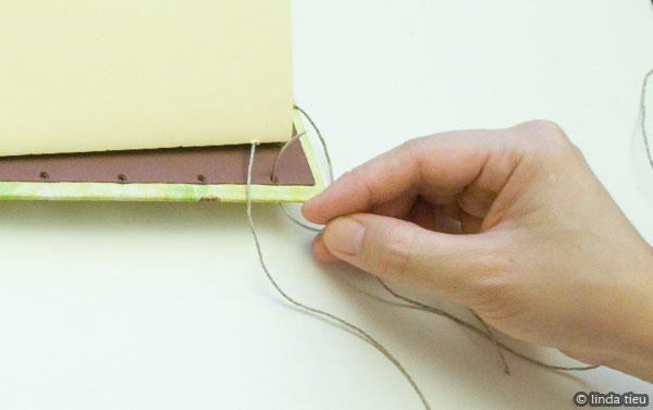 Showing the process of sewing your book