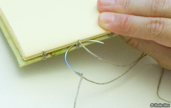 Detail of curved needle for kettle stitch