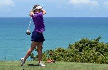 a golfer holding a golf iron