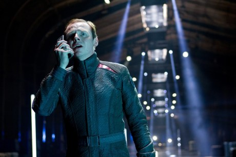 simon pegg as scotty taking a cell phone call into darkness