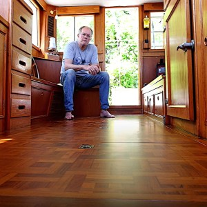 Nautical photographer Onne van der Wal in the restored cabin of his Grand Banks 32