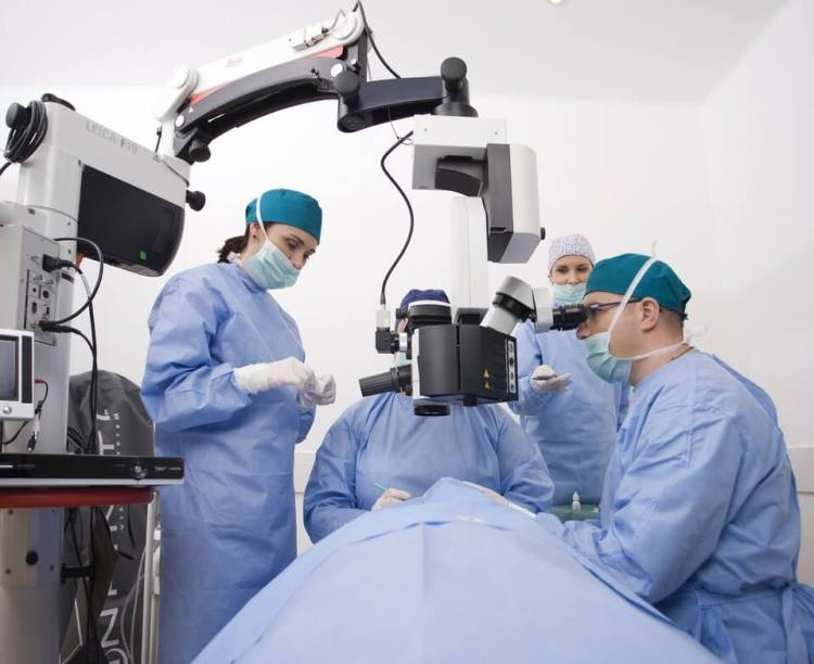 doctors performing a laser eye surgery