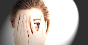 woman suffering from photophobia