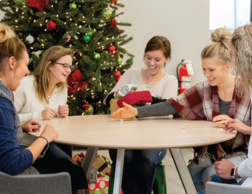 Group of young women playing Christmas party games