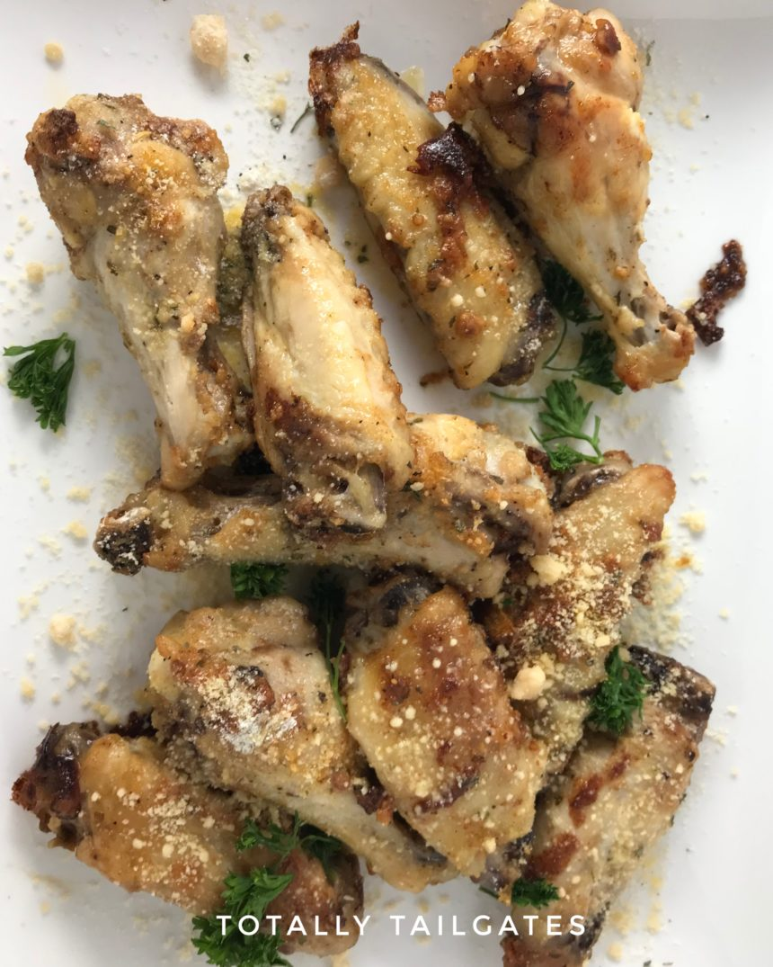 Garlicky Parmesan Chicken Wings are a family favorite for football tailgate parties!