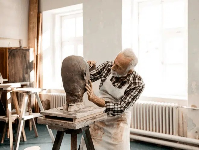 Man pursuing his passion in sculpting