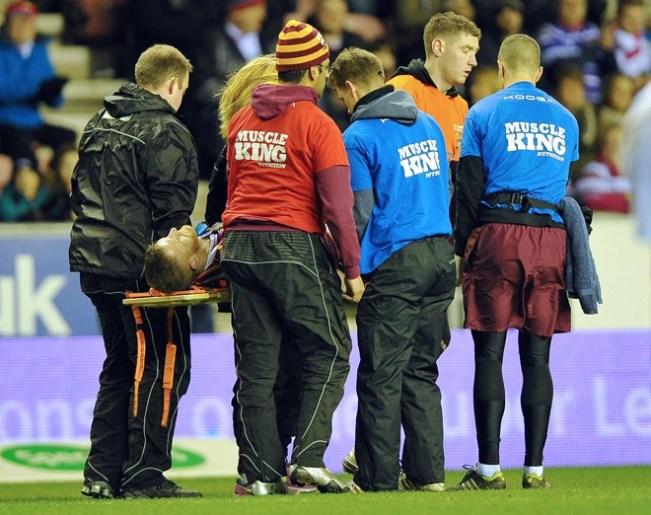 Larne Patrick getting stretchered off against Wigan. ©RLPhotos