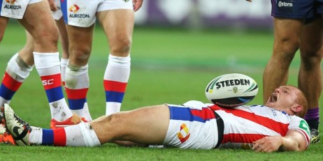 McKinnon in agony after landing on his head. ©Action