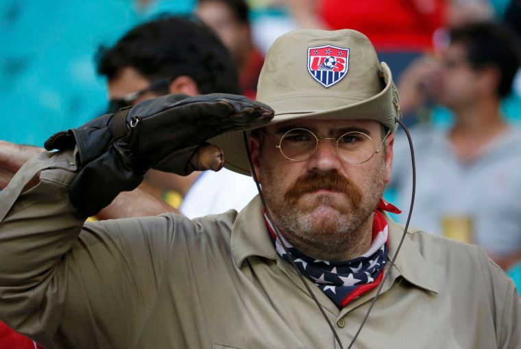 ORG XMIT: PSQ47 REFILE WITH ADDITIONAL INFORMATION    Mike D'Amico of the U.S., also known by his alter ego Teddy Goalsevelt, salutes before for the 2014 World Cup round of 16 game between U.S. and Belgium at the Fonte Nova arena in Salvador July 1, 2014.  REUTERS/Sergio Moraes (BRAZIL  - Tags: SOCCER SPORT WORLD CUP)