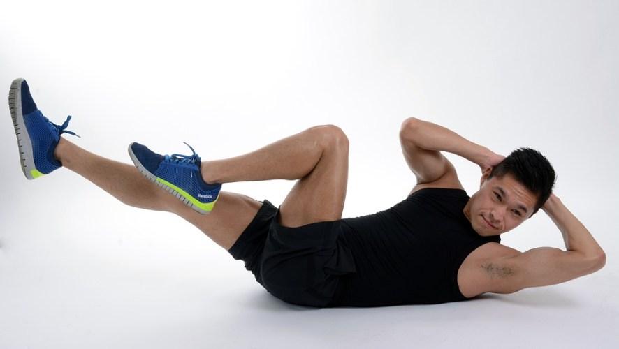 Man on side planking