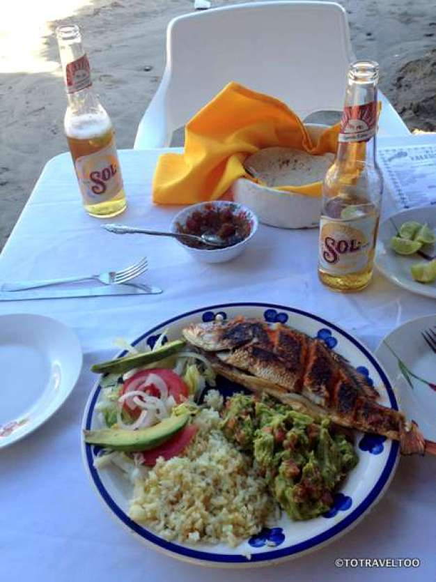 One of our favourite meals, fresh red schnapper, guacamole and Sol Beer on the beach at Zihuatanejo