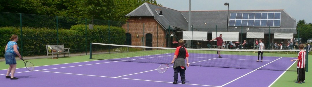 A family enjoying a game tennis after hiring a court