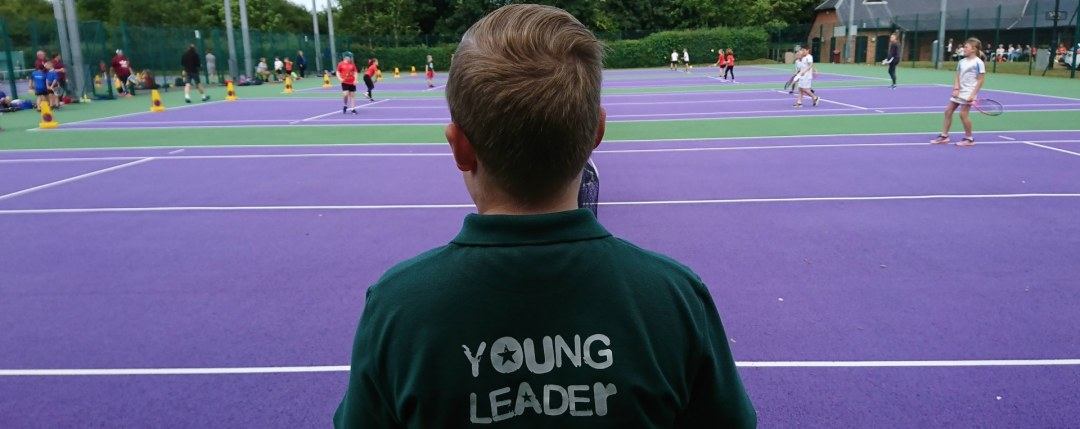School tennis coaching, with children visiting the tennis centre to play in an inter-school festival
