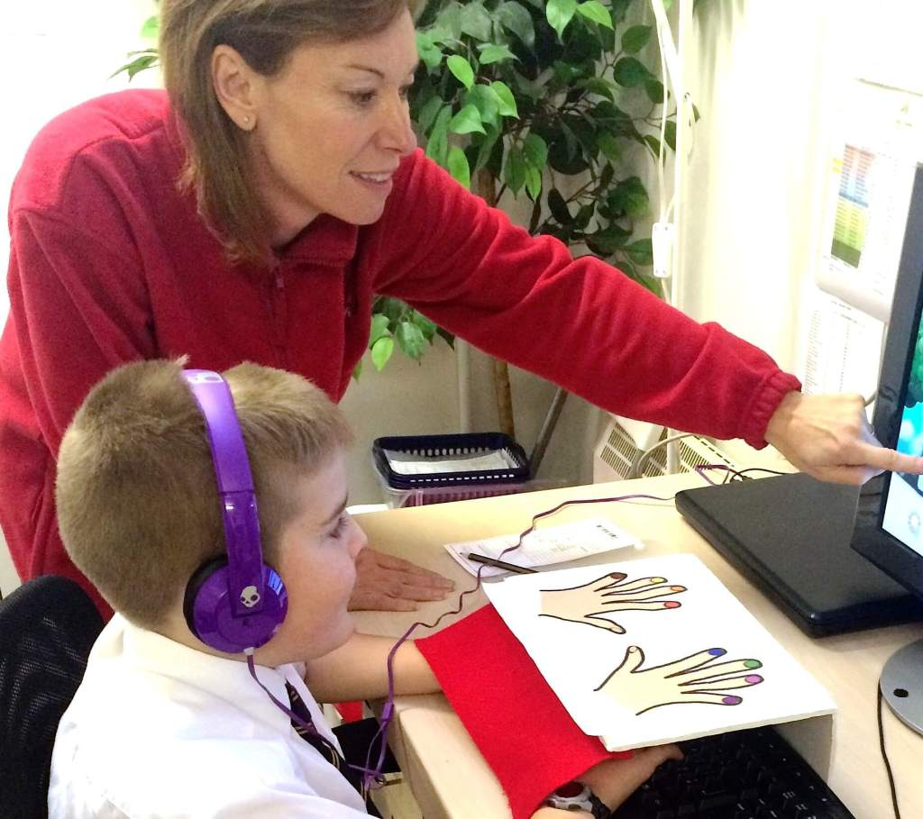 Child learning how to touch type
