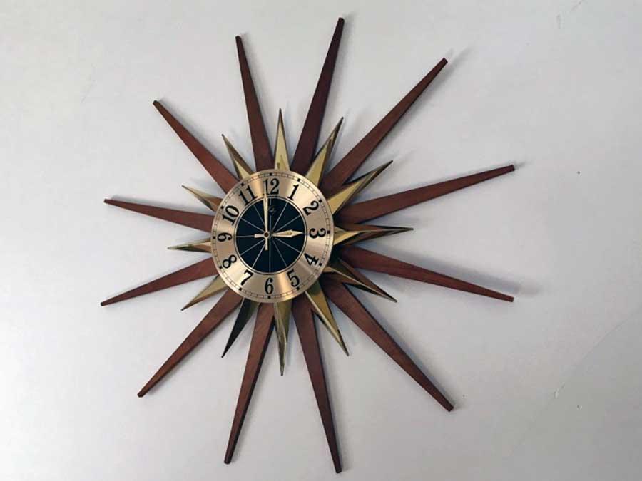 Mid century modern teak and brass Welby starburst wall clock