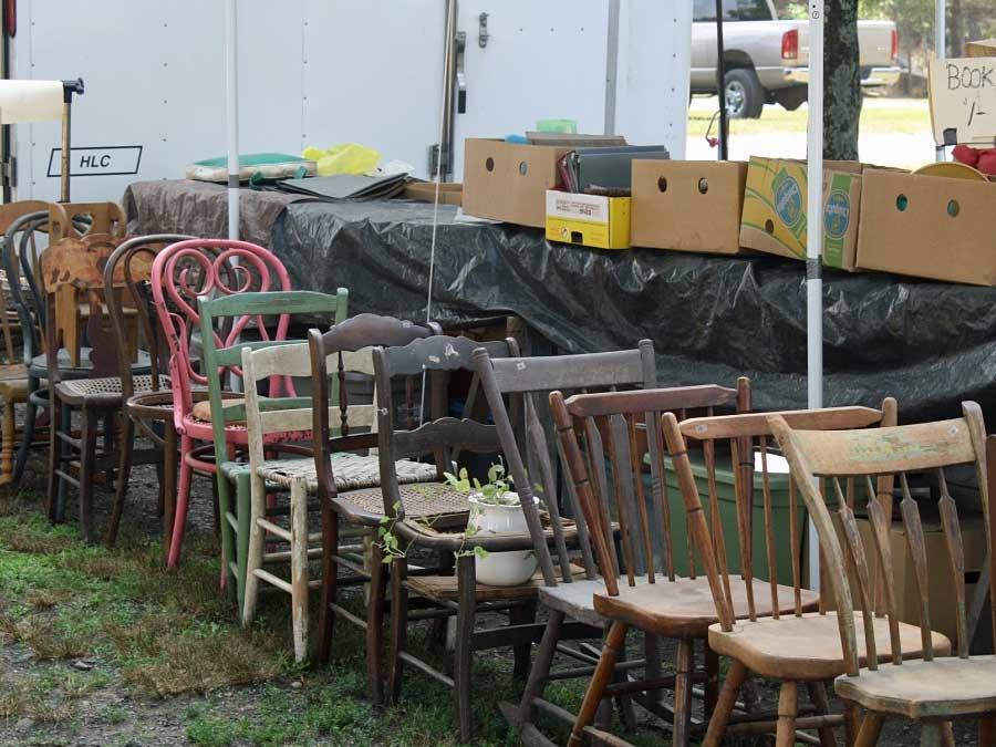 old chairs on display at flea market are good places to find vintage home decor