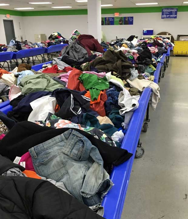 Goodwill outlet store blue bins filled with clothing