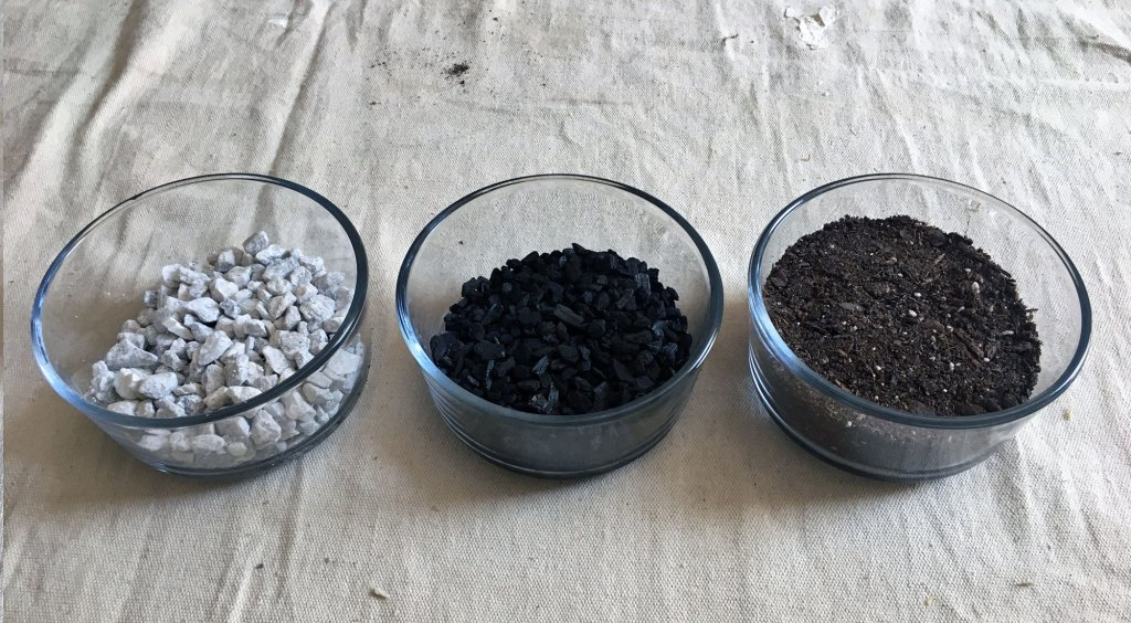 white gravel, charcoal and soil used in terrarium